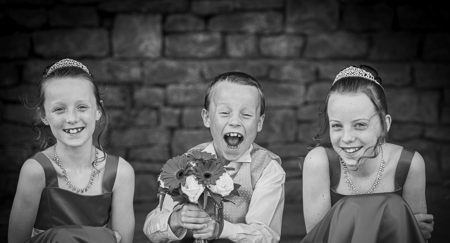 cheeky children at wedding black and wite