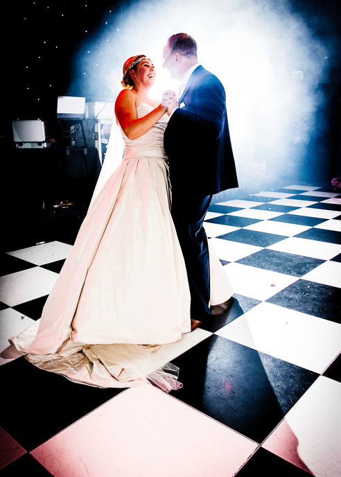 bride and groom first dance chequered floor smoke