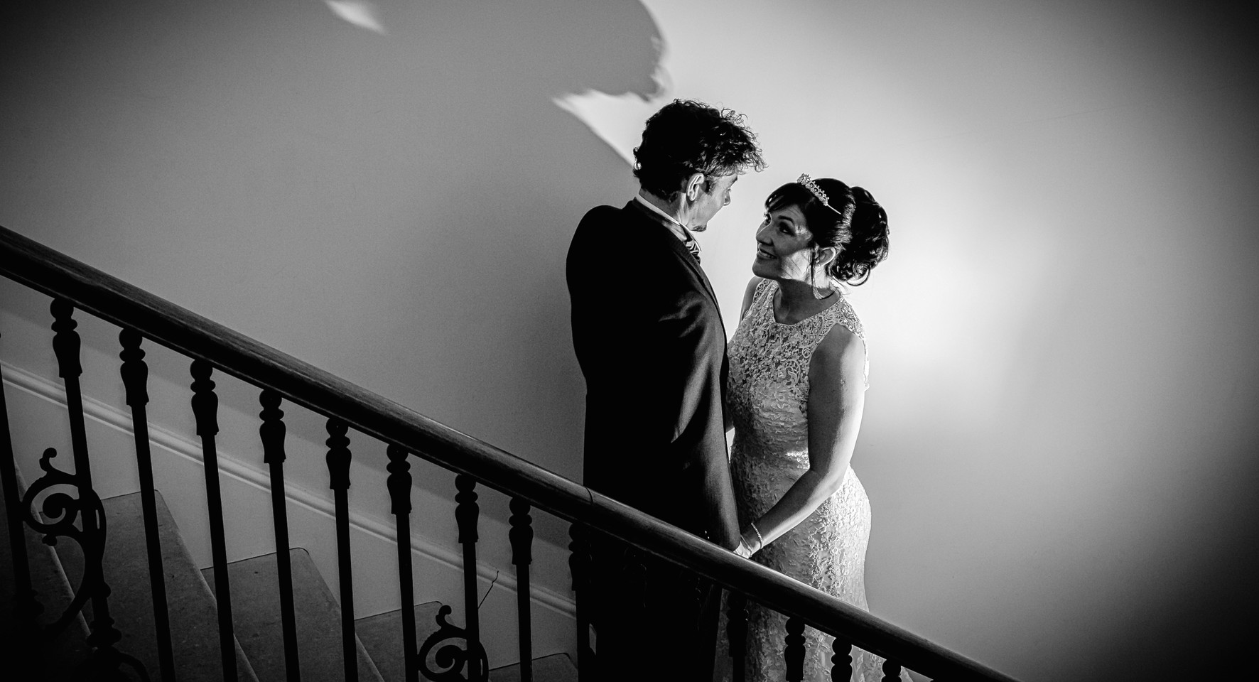 bride and groom on stiars shadow black and white