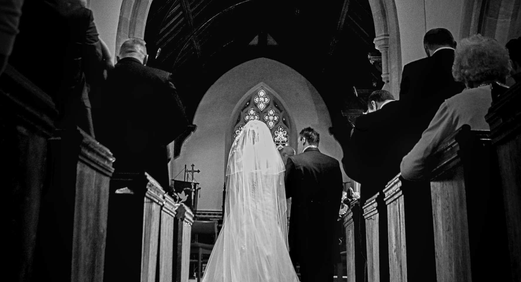 bride and groom long altar black and white