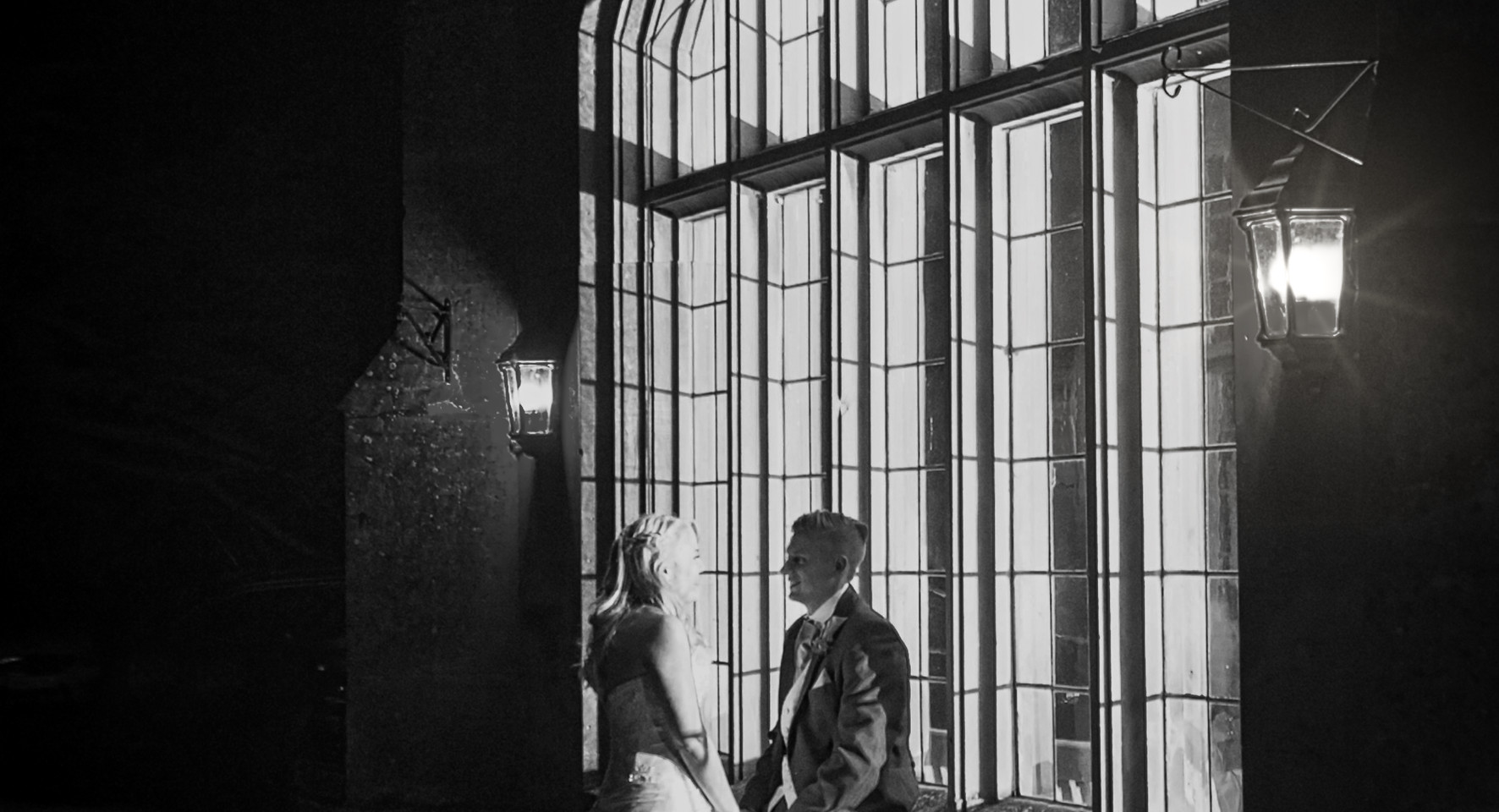 beide and groom nightime large window black and white