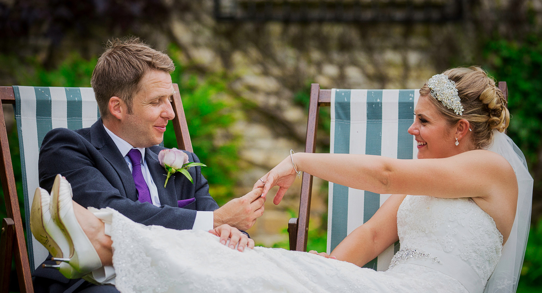 bride and greoom deckchairs ring inspection