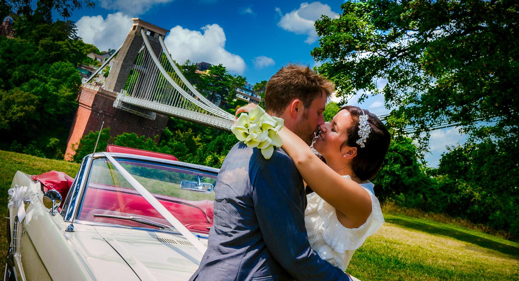 bride and groom post clifton bridge classic car