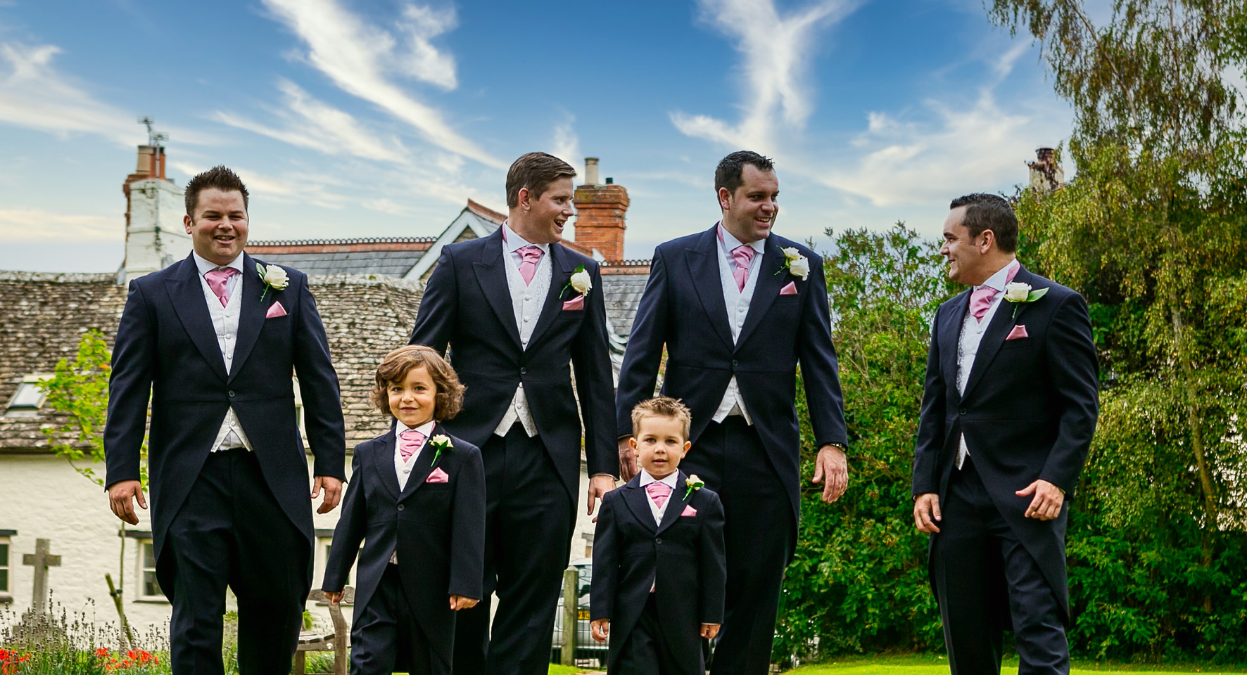 groomsmen and boys walk to church