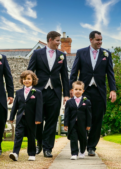 groomsmen and boys walk to church