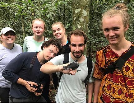 Norwegian students holding an antbird during a Fauna Forever bird survey