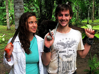 Two Fauna Forever research volunteers holding machetes