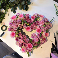Rose and carnation heart tribute