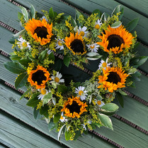 Sunflower, daisy and solidago heart centre piece