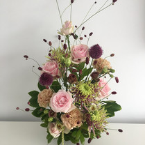 Chrysanthemum, rose, carnation and allium display