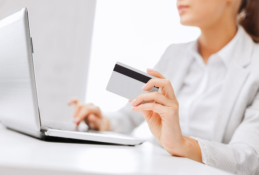 woman-paying-online-with-creidt-card-e14