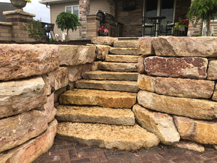 Natural stone retaining wall and steps