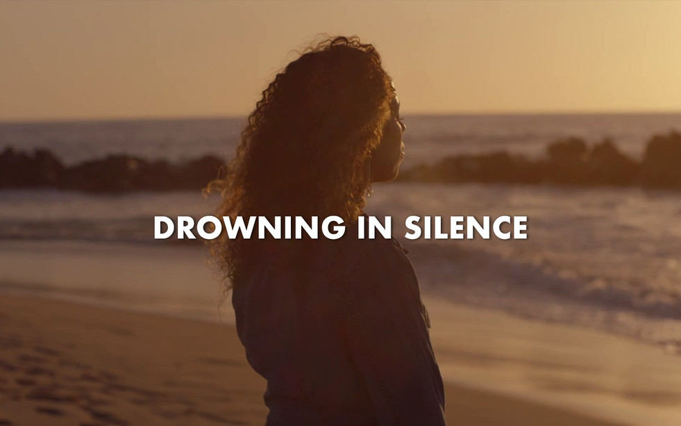 DROWNING IN SILENCE