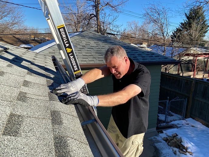 Dehn working on a roof.