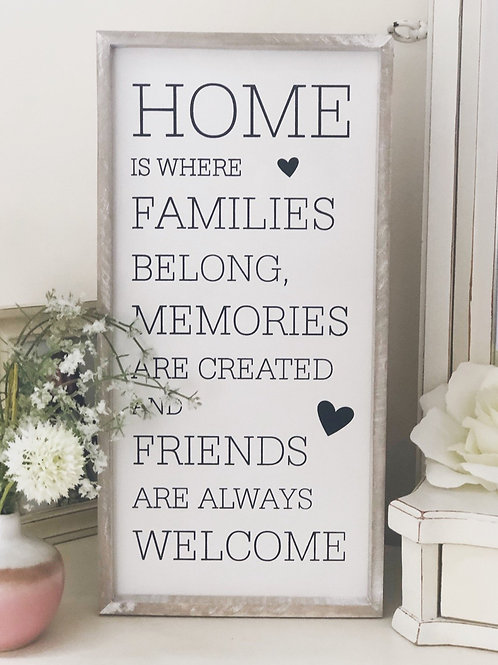 'Home Is Where Families Belong' Sign
