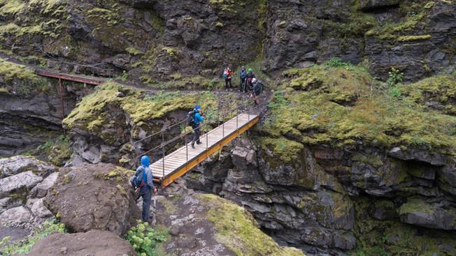Crossing a high bridge over a river