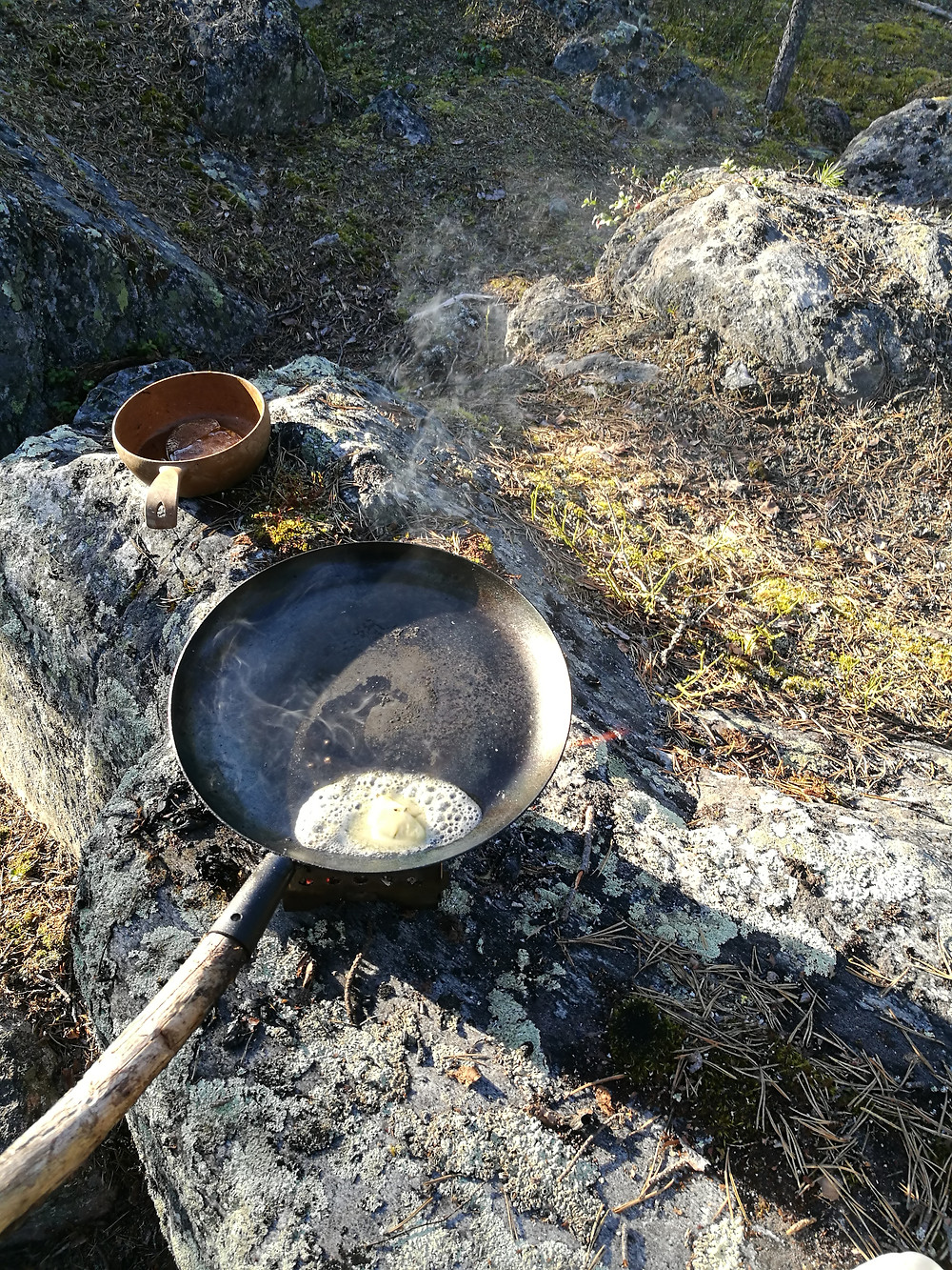 Melting butter in a pan - Feast in the Wild