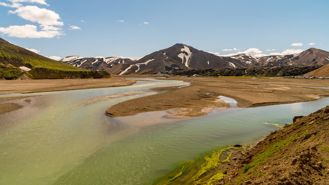 Mixture of glacial rivers and geothermal rivers