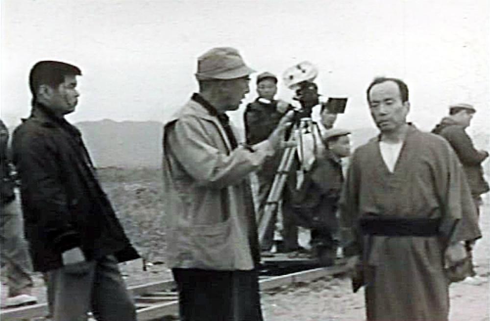 FILE PHOTO: Dir. Tomu Uchida (C-front) directing Jyunzaburou Ban (R-front). ©TOEI