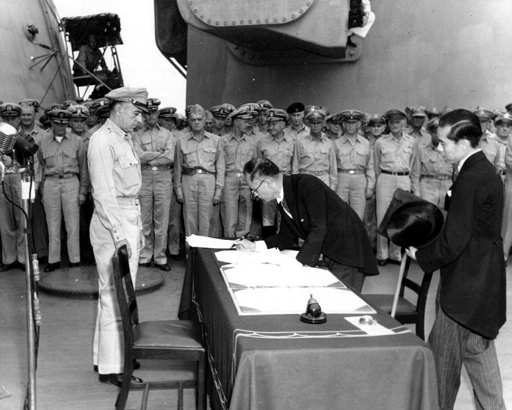 File Photo: Japanese Foreign Minister Mamoru Shigemitsu signs the Instrument of Surrender on behalf of the Japanese Government, on board USS Missouri (BB-63), 2 September 1945.  Image: Wikimedia=Wikipedia