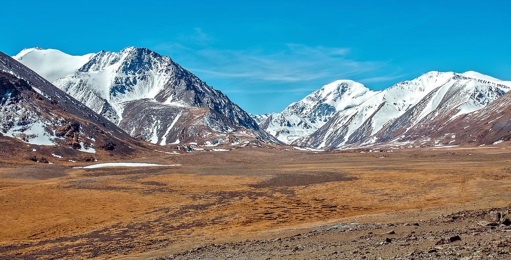 FILE PHOTO: Snowy mountains. Russia, Siberia, Altai mountains  ©envato / oxygen2608