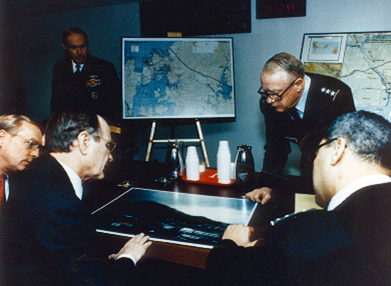 File Photo: President George H.W. Bush being briefed by the Defense Intelligence Agency (DIA) during the 1989 US invasion of Panama. Image: Wikimedia=Wikipedia