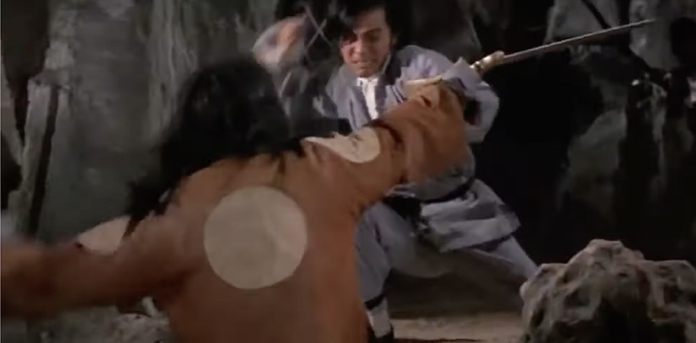 FILE PHOTO: Fig.6  David Chiang Tai-wai hits another vampire in a tighter shot. © Hammer Film Productions / Shaw Brothers