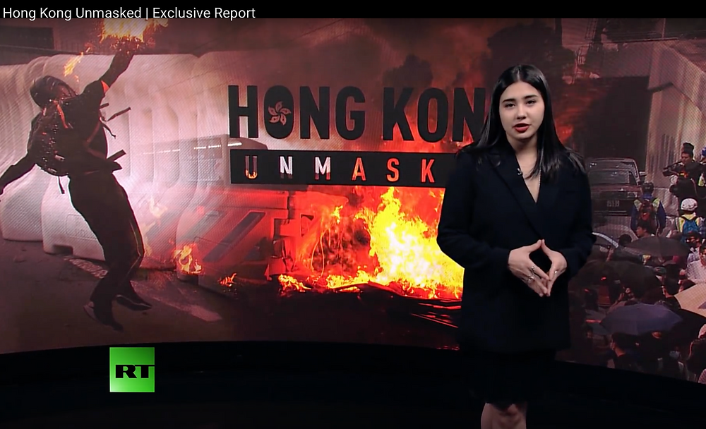 "Hong Kong's violent anti-government movement continues to rage. It has won the world's attention and the support from politicians in the West. But what's really fueling the chaos? Through exclusive interviews and copious research, RT America's Michele Greenstein, who was an eyewitness to the violence, paints a comprehensive picture of the protests. ""Hong Kong Unmasked"" explains what sparked the unrest and the social problems that fuel it, and it reveals how forces in Washington have exploited it for their own ends."