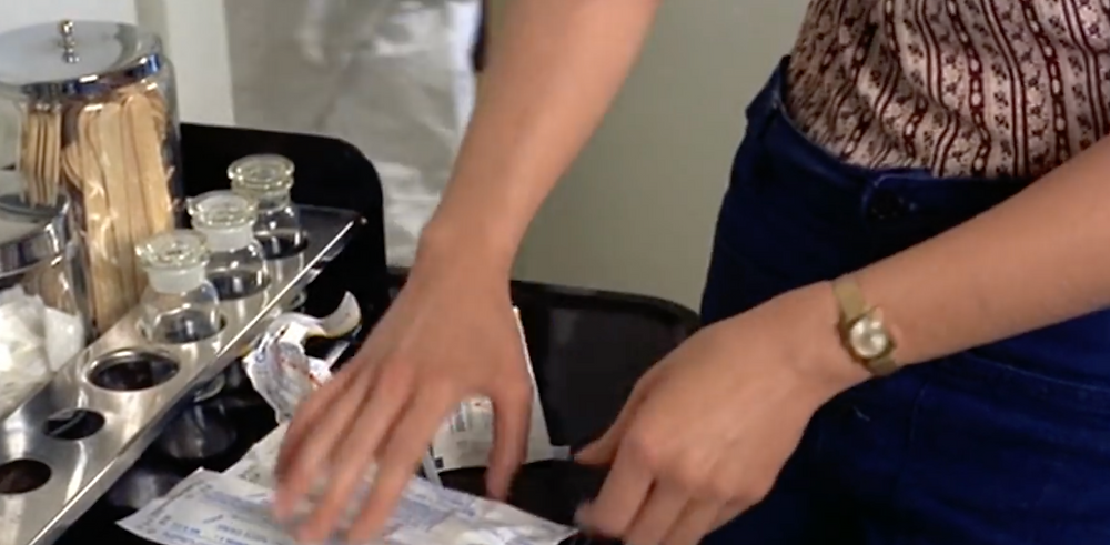 Fig.10: A cutaway shot of Judy's hands stealing vaccines.   ©Youtube