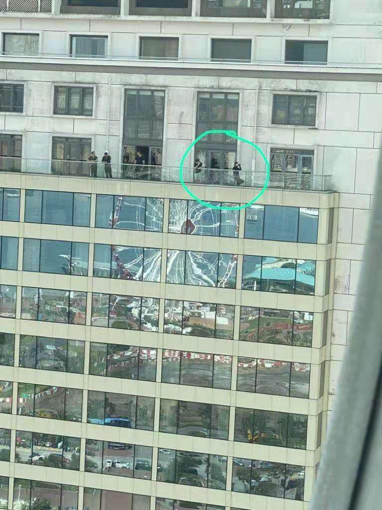 Fig3 PHOTO FILE: It shows black shirted rioters are at the balcony of the presidential room of Mandarin Oriental Hotel.  Image: Internets