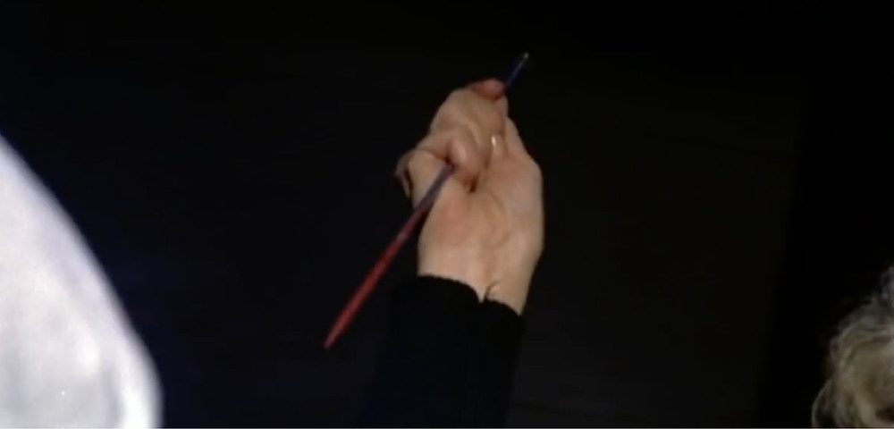 Fig.37: A woman's rising hand with a knitting needle . ©Youtube