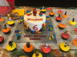 Lego-real-themed cake and cupcakes