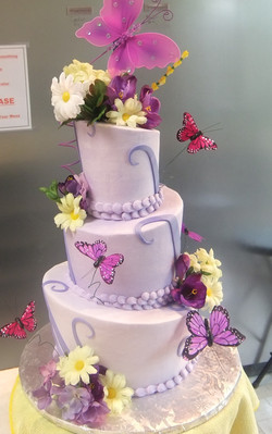 Whimsy-Butterfly cake with silk flowers.