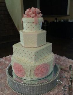 Big pink rosettes wedding cake