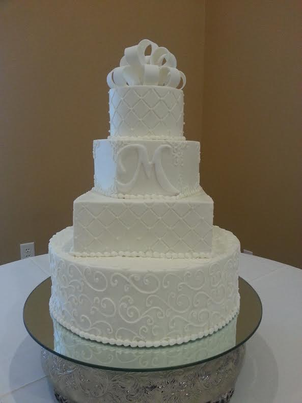 Multi shaped wed cake with monogram