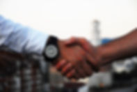 Canva - Two Businessmen Doing a Handshak