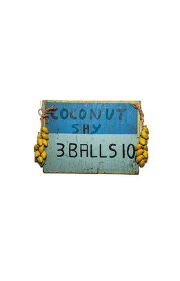 1960's coconut shy advertisement board, 3 balls 10p, 7 balls 20p. London (2011).