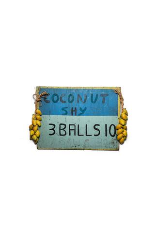 1960's coconut shy advertisement board, 3 balls 10p, 7 balls 20p. London (2011).