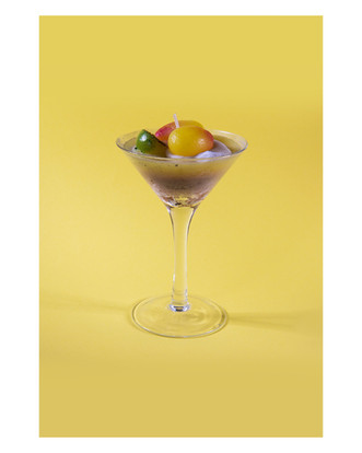 YELLOW: Cocktail glass with fruit shaped wax candle.