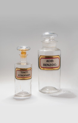 Medicine bottles, strophanthus tincture and benzoic acid.
