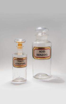 Medicine bottles, strophanthus tincture and benzoic acid.