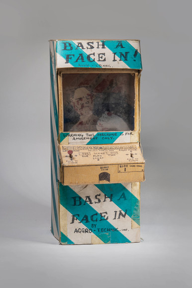 'Bash a Face In' by Aggro-Technic Corp. Homemade arcade machine, cardboard. Warning this machine is for amusement only.