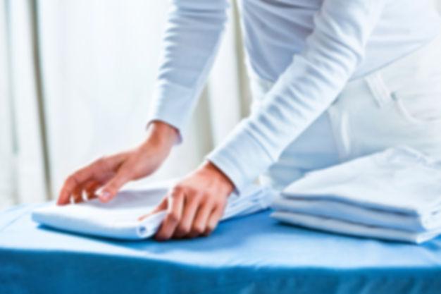 Woman folding shirts