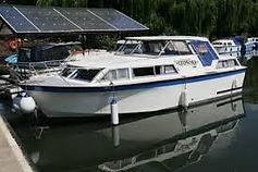 narrowboat moving and river cruiser moving