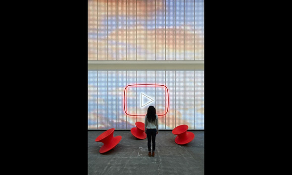Girl in front of logo .jpg