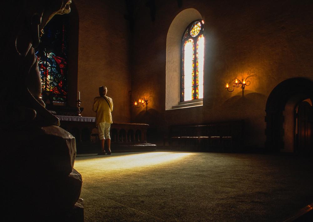 spiritual seeker in a chapel