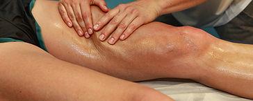 Advance massage on leg to loosen tissue adhesions at CSpaBoston.com