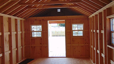 interior of a board and batten recreational cabin unfinished