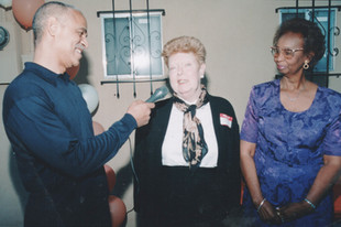Wooten with volunteer Mary Talley and Wooten founder Myrtle Faye Rumph at the center