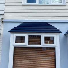 Modernised result using 'pastel blue' thin coat system to replace old pebble dash exterior.